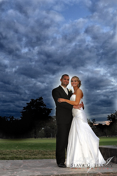Bride and Groom standing on the golf course at Pine Forest Country Club