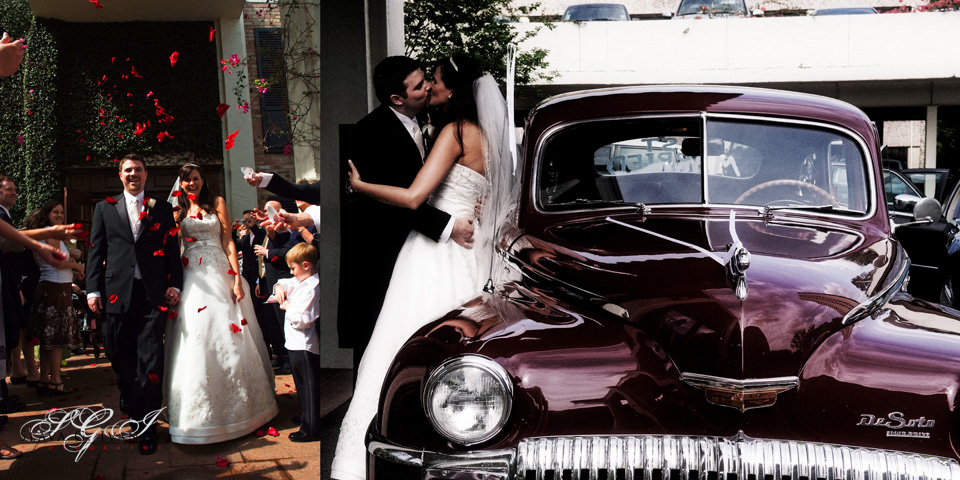 Bride and groom kissing at the get away car