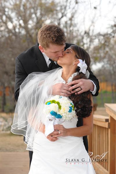 Our lovely bride and groom kissing in front of Texas Old Town
