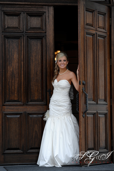 Bride picking through the door of Ashelynn Manor Chapel