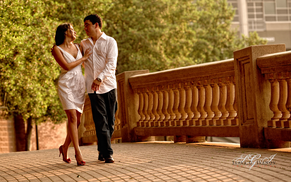 engagement photoshoot of a couple taking a walk along the bank of a river