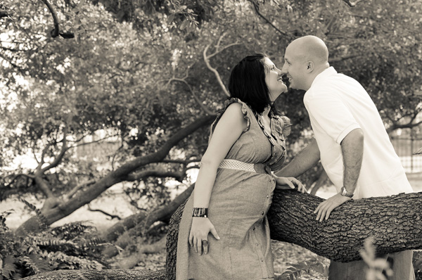 Loving expecting couple posing for a maternity photo in Houston