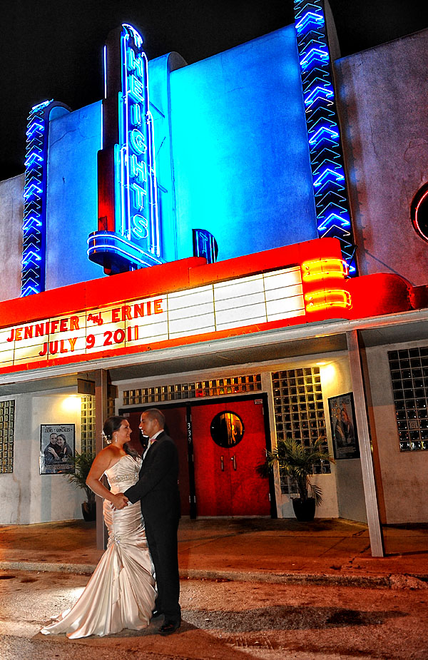 Bride and groom kissing in front of Old Heights Theater now Gallery M Squared