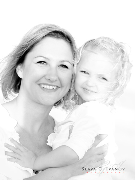 portrait of a young monther and her daughter posing for photographer on Galveton Beach