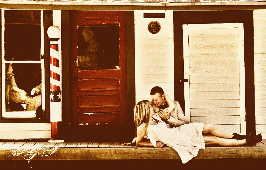 Fun, vintage style engagement photo of a couple in the historic district of League City.