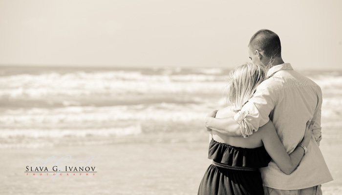 Engaged couple is been photographed on Galveston Beach