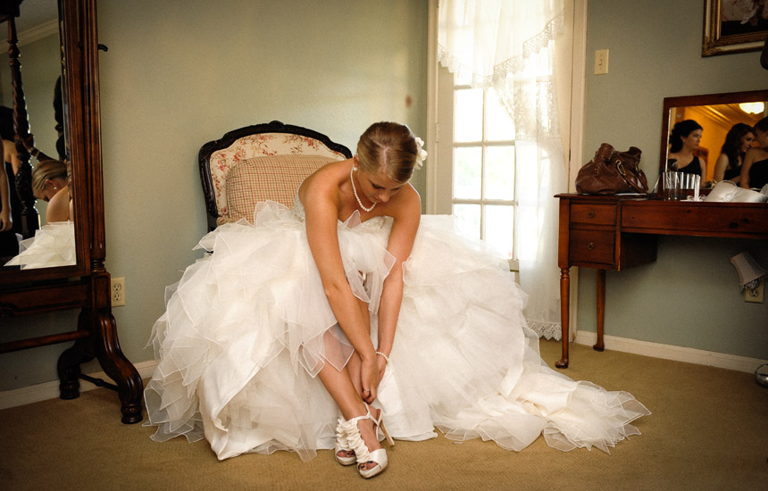 Bride is getting ready at Ashelynn Manor in her room for the wedding ceremony at the chapel