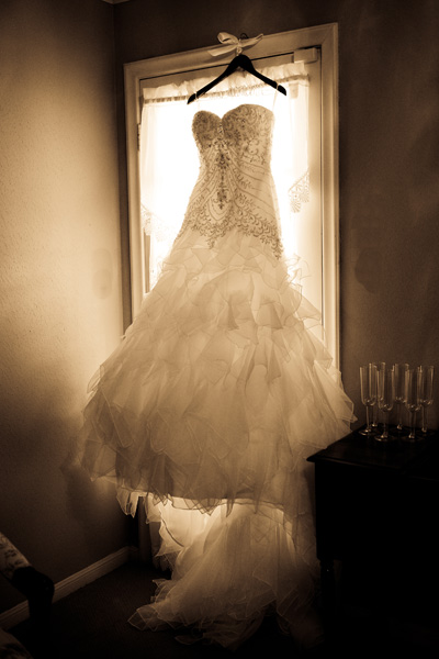 wedding dress hanging in the window at Ashelynn Manor
