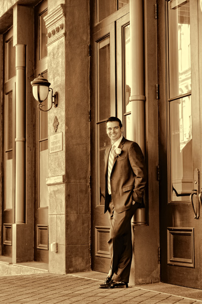 Happy Groom is been photographed near by of the Tremont House Hotel in Galveston Texas before his wedding