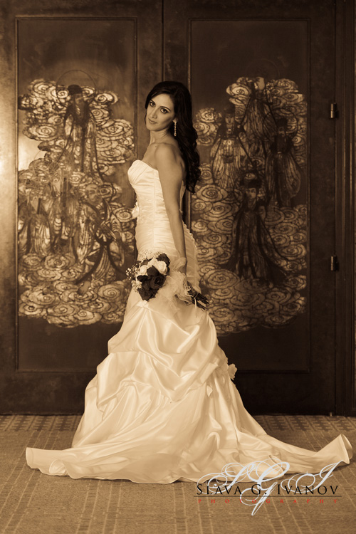 Bride posing in front of the wedding reception hall at the Four Seasons Hotel in Houston Texas
