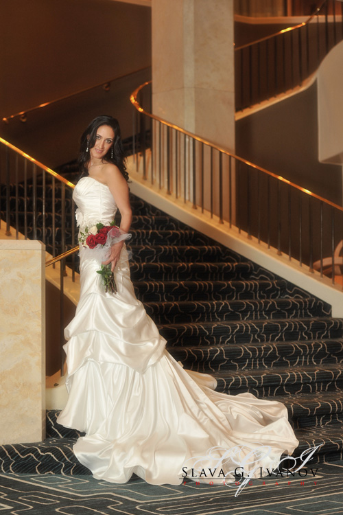 Bride posing for the final photo of the bridal photography session in the lobby of the four seasons houtel
